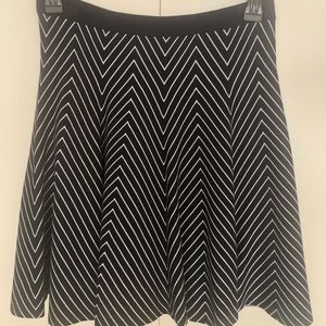 Black and white trapeze skirt.